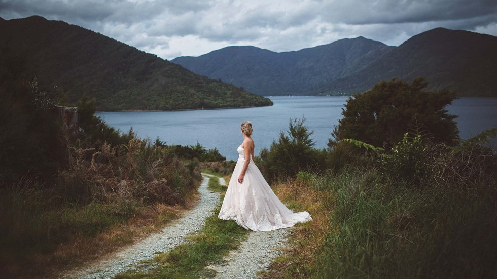 Endeavour Inlet provides scenic views and a background for this bride to admire at Punga Cove in New Zealand's South Island Marlborough Sounds