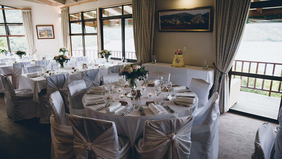 Wedding reception dining at the Punga Fern Restaurant can be indoor or outdoor with seating available for each preference and surrounding views of Punga Cove and Endeavour Inlet in the Marlborough Sounds of New Zealand