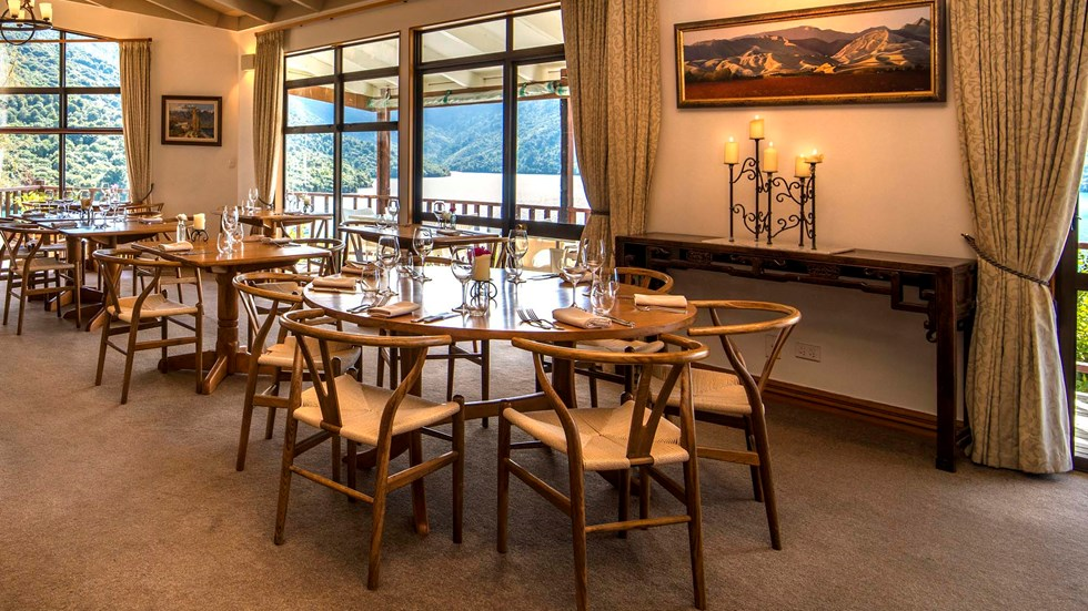Dining at the Punga Fern Restaurant can be indoor or outdoor with seating available for each preference and surrounding views of Punga Cove and Endeavour Inlet in the Marlborough Sounds of New Zealand