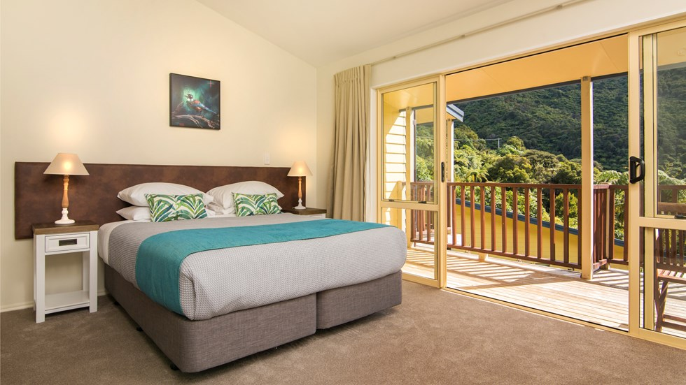 Fern Studios include a spacious bedroom with a private balcony for relaxing and enjoying scenic Endeavour Inlet views at Punga Cove in the Marlborough Sounds of New Zealand