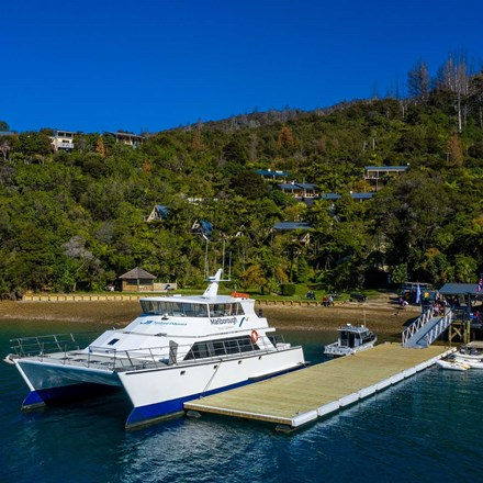Large commercial vessel can park easily at Punga Cove's jetty located at the bottom of the accommodation property in the Marlborough Sounds in New Zealand's top of the South Island